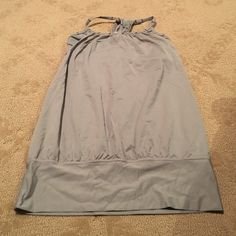 Lulu lemon size 4 sports bra with attached top Lulu lemon size 4 gray awesome, makes you fabulous, hides all of your belly flaws because it blouses over!! So flattering and supper comfy too! I have it in orange and black all for sale lululemon athletica Tops Tank Tops