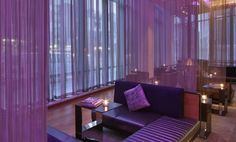 Beautiful purple lights illuminate the coiled wire mesh backdrop done by Cascade Coil for W Hotel in Boston