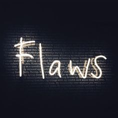 "A WHITE NEON SIGN THAT READS "" FLAWS"""