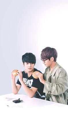 VKOOK<< Jungkook looks like he really really wants to take a bite of Taes burger