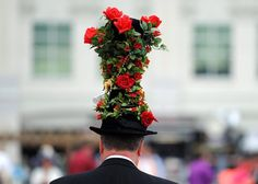 LOUISVILLE, KY - MAY 04: A race fan wearing a festive hat attends the 139th running of the Kentucky Derby at Churchill Downs on May 4, 2013 in Louisville, Kentucky. (Photo by Rob Carr/Getty Images)