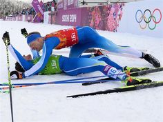 Sami Jauhojaervi (bottom) of Finland celebrates with teammate Iivo Niskanen after winning the gold medal in the Men's Team Sprint Classic Final, during Day 13 of the Sochi 2014 Winter Olympics at Laura Cross-Country Ski & Biathlon Center. Sochi 2014 Day 13 - Cross Country Men's Team Sprint Classic.