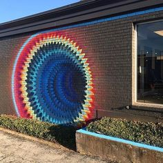 Hoxxoh working on a new piece in Texas #streetart @hoxxoh