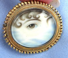 Direct attention is paid to the eye in this particular brooch; detail that is flanked by its art and directly creates a mood to its setting.