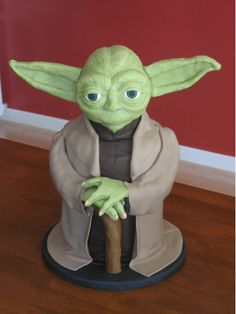 """Yoda - Yoda, for my son's 6th birthday.  Yoda's body is 5-8"""" rounds covered in fondant, head is RKT covered with modeling chocolate,  Yoda's ears and hands are modeling chocolate, cane is fondant."""