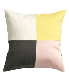 Cushion cover with color-block front, solid-color backing, and concealed zip. Size 20 x 20 in.
