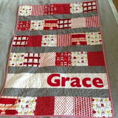 "Fun, easy cute baby quilt.  Just picture. no tutorial..... It looks like 7""squares six across then 4"" strip then a 7"" strip then a 4"" strip... Then alternate a rows of 7"" squares then 4"" strips.  Appliqued name"