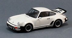 1975 Porsche 911 Turbo in White 1:43 scale diecast car. This 1:43 scale 1975 Porsche 911 Turbo in white 1:43 scale diecast car is made by Kyosho, part # 5524W. It is a very detailed 1:43 scale car with opening hood and trunk/engine cover. $88.20 http://www.kcautoacc.com/1975-Porsche-911-Turbo-White-143-Scale-Diecast-Kyosho-5524W_p_15730.html