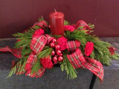 Love the feel of the tartan ribbon and Christmas ball ornaments in this Christmas arrangement.
