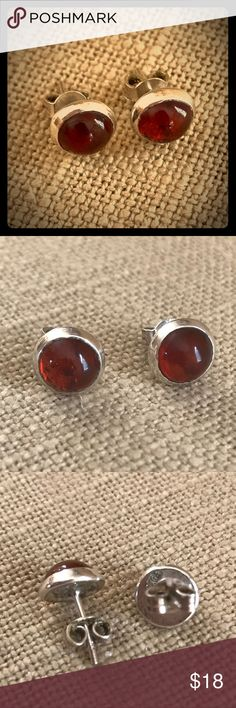 Vintage Baltic Amber Silver Earrings Lovely pair of Baltic honey amber earrings. It's difficult to decipher the markings on the back but I suspect they are the makers hallmark. I cannot locate the 925 marking but the earrings do have the patina of sterling silver. Nice vintage condition. Vintage Jewelry Earrings
