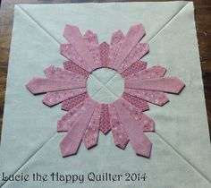 Lucie The Happy Quilter's Blog | Sewing Tales of a Longarm Quilter -- what a unique dresden plate block!