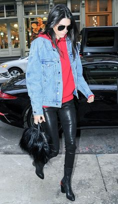 Kendall Jenner pairs a denim jacket with a bright red hoodie, black leather skinny pants, a fur bag, and black booties Source by WhoWhatWear Look Fashion, Trendy Fashion, Winter Fashion, Trendy Style, Fashion Styles, Fashion Clothes, Street Fashion, Fashion Design, Celebrity Outfits