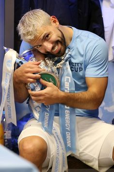 Sergio Aguero of Manchester City celebrates victory with the trophy in the dressign room after the Carabao Cup Final between Chelsea and Manchester City at Wembley Stadium on February 2019 in. Get premium, high resolution news photos at Getty Images Manchester Love, Manchester City Wallpaper, Sergio Aguero, Lionel Messi Wallpapers, Kun Aguero, Soccer Pictures, Zen, Wembley Stadium, Football Boys