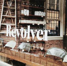 Revolver Storefront Window Signage   Rugged Industrial Retail Interior