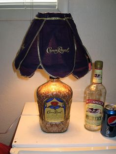 DIY Whiskey bottle lamp. Pretty Neat project, not sure about using a crown royal bottle and the lamp shade tho.