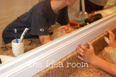 I've been looking at moldings for framing our bathroom mirrors - here they used baseboard molding rather than crown molding.... I think I like it better!!