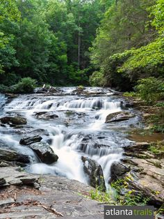 The lower Panther Creek falls, flowing in small cascades over a large rock outcrop