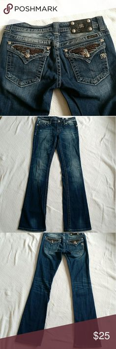 """Miss Me Jeans Sz 29 Boot Cut Zipper-Teeth Style Women's Miss Me Denim Jeans Size 29 Boot Cut Style: JP5189B2 Color: VTG 278 Light factory-made distressing Has stretch: 98% Cotton & 2% Elastin Actual measurements- Waist laid flat across: 15"""" Rise: 8"""" Inseam: 34.5"""" Zipper-teeth styled pockets. Corners of pockets have rhinestone gems. Right along the waist there is some darkened areas. I took a few close-ups (one is right around the black logo and the other is top of the waist line). Otherwise…"""
