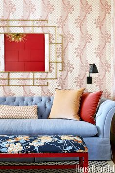 "In a sitting area adjacent to the master suite, the designer lined the space with Kinnicutt, a Sister Parish wallpaper ""with a timeless, happy personality."" The seat on the vintage bench is covered in Bob Collins's Spice Rose; the sofa is by Hickory Chair."