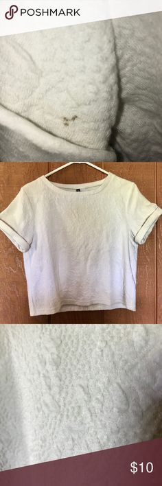 White Textured Comfortable Crop Top   H&M This is a super comfortable shirt that I really loved! It is a little cropped, but your stomach won't be completely out if you're shorter. It is also very nice quality since the material feels a little quilted. There is one small brown spot on the sleeve, but the sleeves really disguise it. H&M Tops Crop Tops
