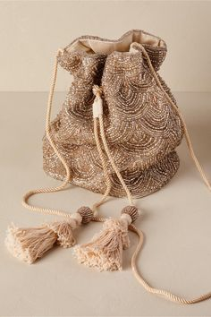 Umbria Bag - Evening Bag - This handmade drawstring pouch features scalloped beading in muted metallics and on-trend tassels. Slide View: Umbria Bag – my site You got to start a date when using the night - until you need a stlylish grip to get done with Beaded Purses, Beaded Bags, Vintage Purses, Vintage Bags, Bridal Accessories, Fashion Accessories, Ethno Style, Potli Bags, Mode Inspiration