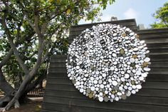 George Sherwood  My favorite piece of art at the San Diego Botanic Garden.  Each shiny circle moves in the wind.  $135k