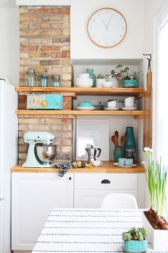 """Love the copper and blue and wood together. Could make a shelf matrix on the dining wall to house extras on counter tops to create more kitchen space while also creating """"functional art""""."""