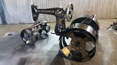 Singer Sewing machine with fabricated tires, wheels and fenders.