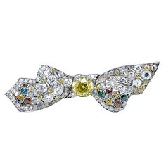 Colored Diamond Bow Brooch, ca. 1920