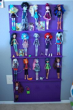 My neighbor made this Monster High Doll Display.  I love it!!  I wasn't a fan of the dolls until I saw this!!