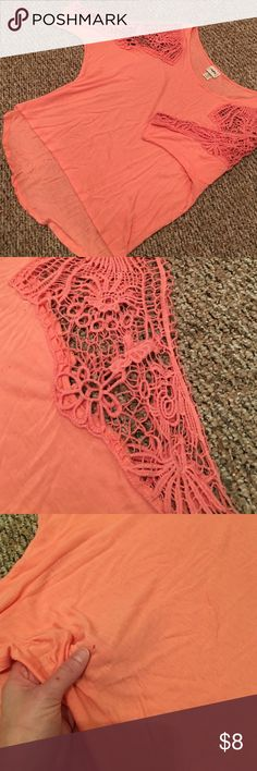 Crochet shoulder blouse Peachy coral color. Beautiful crochet shoulder design. Tiny hole in front of shirt. Price reflects this. Daytrip Tops Blouses