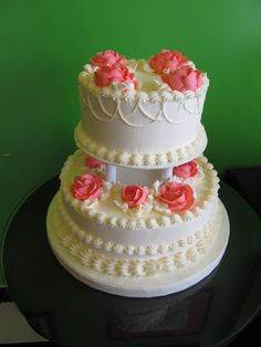A simple, but elegant two tiered wedding cake with decorative piping, pillars, and coral buttercream roses. Cake by Tasteful Cakes in Corona, CA. Small Wedding Cakes, Wedding Cake Roses, White Wedding Cakes, Elegant Wedding Cakes, Beautiful Wedding Cakes, Beautiful Cakes, Wedding Flowers, Buttercream Cake Designs, Buttercream Wedding Cake