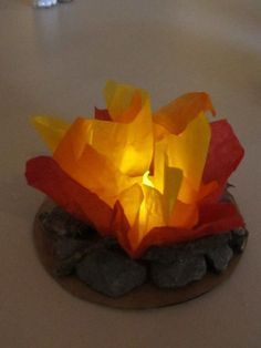 "Indoor campfire with flame less candle. Cute Blue and Gold center pieces! ""We made a larger on for our VBS quiet time around the camp fire, It was hit with our kids and adults! """