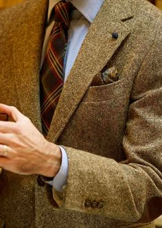 Beige tweed jacket, light blue shirt, red & navy plaid tie