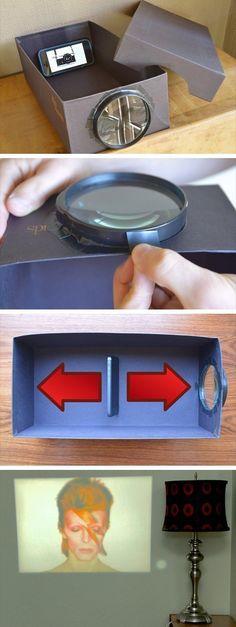 Tee kännykästäsi videotykki: leikkaa kenkälaatikon päätyyn reikä ja teippaa siihen suurennuslasi. Tee kännykälle teline klemmareista taivuttamalla ja laita kännykkä kenkälaatikkoon niin, että kuva on väärin päin (suurennuslasi kääntää sen oikein päin). Saat heijastettavan kuvan tarkkuutta säädettyä muuttamalla kännykän etäisyyttä suurennuslasista.