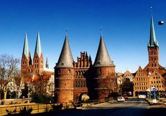 """City of Lubeck - a UNESCO World Heritage Site. This medieval city was the capital of the Hanseatic League over the centuries. Its various monuments are magnificent examples of a style specific to the North German: the """"Brick Gothic"""" or gothic brick. This style does not characterize only the religious monuments of the city, but also its town hall and townhouse. This architecture is very elegant and reflects the wealth of the city in the middle ages."""