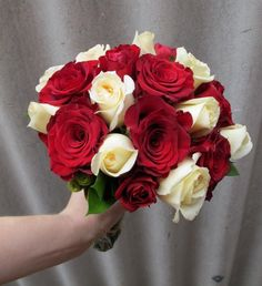 Red & White Rose Wedding Bouquet.  Flowers of Charlotte loves this!   Find us at www.charlotteweddingflorist.com
