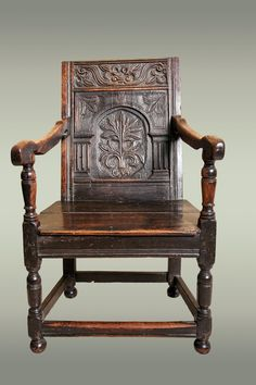 Small joined oak armchair, with applied carved arcaded back panel with a floral display within arcade. The top rail with ornate s-scrolls.  This armchair is possibly an older child's chair, as it is too small for an adult but too large for a young child.   Origin: West Country, England  Date: Circa 1650  Dimensions: Width 23 x Height 35 1/2 x Depth 21 3/4