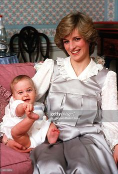 February A baby Prince William with his mother, The Princess of Wales, at home in Kensington Palace, London. Princess Diana wearing a silver pinafore style dress with a white blouse underneath. Prince William is about 8 months old here. Princess Kate, Princess Diana Family, Princes Diana, Princess Of Wales, Lady Diana Spencer, Diana Son, Princesa Charlotte, Princesa Margaret, Charles And Diana