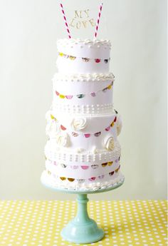 This cake is fun with every sense of the word. Stripped back down to it's creamy buttercream coating (let's be honest- it's the best bit!) and playful mini bunting to inject oodles of colour, this cake serves as a cheerful reminder of the fun to be had on one's special day. :)