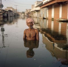 Drowning world A unique series of portraits of flood victims taken within the context of their environmental devastation. Covering the major recent floods in the UK, India, Haiti, Pakistan, Australia and Thailand. | | Gideon MendelGideon Mendel