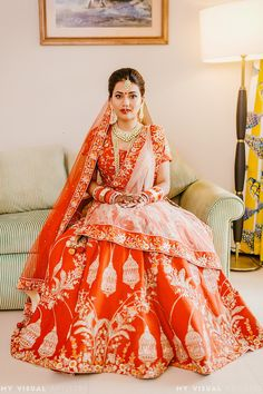 Looking for Lehenga with birdcage motif in red and gold? Browse of latest bridal photos, lehenga & jewelry designs, decor ideas, etc. on WedMeGood Gallery. Designer Bridal Lehenga, Indian Bridal Lehenga, Indian Bridal Outfits, Indian Bridal Fashion, Indian Bridal Wear, Bridal Dresses, Indiana, Orange Lehenga, Choli Dress