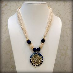 Pendant: Blue Quartz stone with Kundan work on it & Mala: Blue faceted onyx stone , Metal beads & pearl povai
