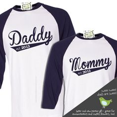 daddy and mommy gift set - personalized year established shirts .. cute newborn photo, on a baseball diamond, baby in onesie & hat.