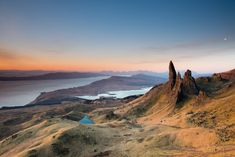 On Scotland's picturesque Isle of Skye sits The Storr – a moonscape-style terrain overlooking the Sound of Raasay. The oddly-shaped, rocky ridges in this a Island Of Skye, British Travel, Travel Uk, Scotland Holidays, Visit Uk, Countries Of The World, Cool Places To Visit, Travel Inspiration, Around The Worlds