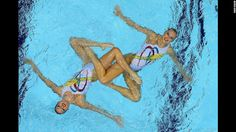 Mary Killman and Mariya Koroleva of the United States compete in the women's duets synchronized swimming free routine final. - CNN.com
