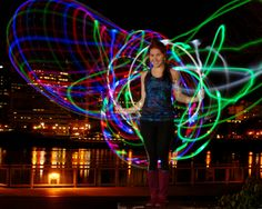Jannae Palovich of Rage Hoops spins colorful light trails into wings with her LED hoops. Photo by … Led Hula Hoop, Led Hoops, Flow Arts, Light Trails, Light Colors, Circles, Plastic, Concert, Bright Colours