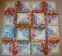 12 new watercolor floral log cabin squares done and some project lay outs