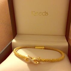 Infinity Gold & Diamond Bracelet From Reeds this lovely Infinity Gold & Diamond magnetic closure bracelet. Never worn, in the original box.       NO TRADES      Reeds stopped making this bracelet, very rare. Gold plated over silver. Reeds Accessories