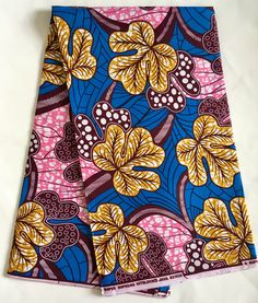 House of Mami Wata African Print Fabrics  https://www.etsy.com/listing/510924284/african-print-fabric-ankara-blue-pink